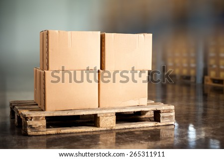 Pallettes with boxes - stock photo