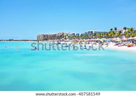 Palm beach at Aruba in the Caribbean Sea - stock photo