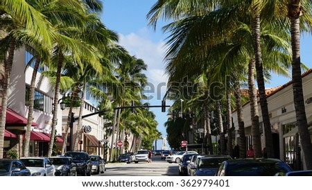 """PALM BEACH, FL - NOV 29: Worth Avenue in Palm Beach, Florida, as seen on Nov 29, 2015. The upscale shopping avenue is voted one of the top three """"Most Iconic"""" streets in America. - stock photo"""
