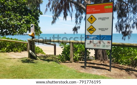Palm Cove Williams Esplanade Cairns.Warning signs for marine stingers and crocodile also no camping or dogs