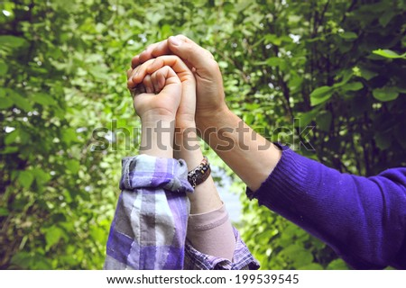 palm family, mother, father and daughter - stock photo