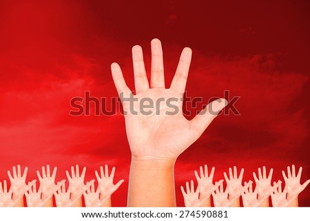 Palm hand show up on red sky and cloud background