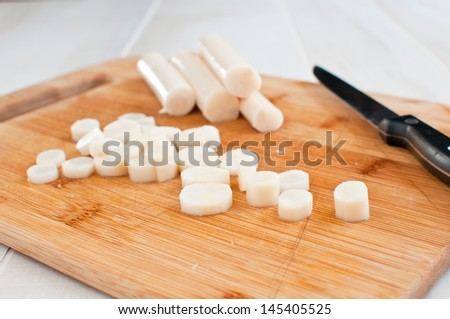Palm heart canned and chopped with knife - stock photo
