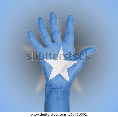 Palm of a woman hand, painted with flag of Somalia