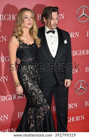 PALM SPRINGS, CA - JANUARY 2, 2016: Actor Johnny Depp & actress wife Amber Heard at the 2016 Palm Springs International Film Festival Awards Gala - stock photo