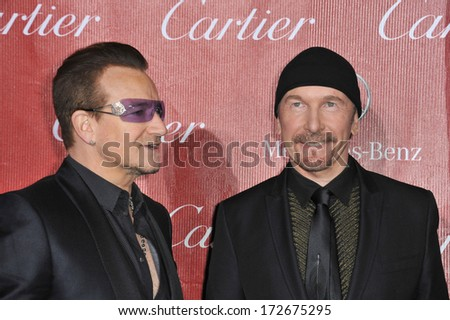 PALM SPRINGS, CA - JANUARY 4, 2014: Bono (left) & The Edge, from U2, at the 2014 Palm Springs International Film Festival Awards gala at the Palm Springs Convention Centre.  - stock photo