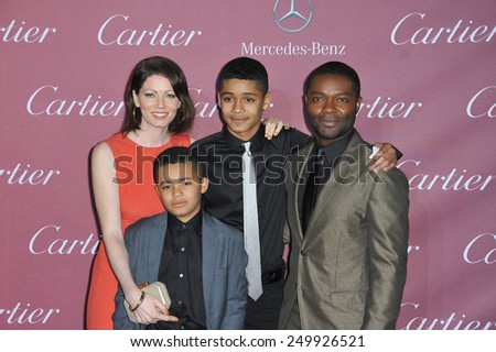 PALM SPRINGS, CA - JANUARY 6, 2015: David Oyelowo & wife Jessica Oyelowo & sons at the 2015 Palm Springs Film Festival Awards Gala at the Palm Springs Convention Centre.  - stock photo