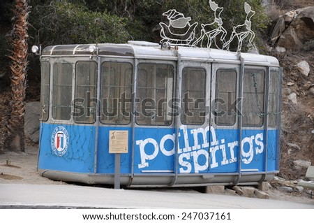 PALM SPRINGS, CALIFORNIA - DEC 16: Palm Springs Aerial Tramway in Palm Springs, California, as seen on Dec 16, 2013. These original tram cars are on static display near the entrance to Valley Station. - stock photo