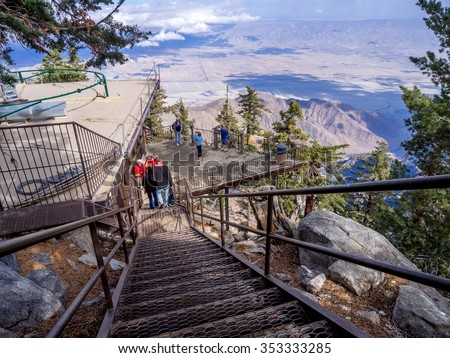 PALM SPRINGS, CALIFORNIA - NOV 15: Tourists enjoying the view at the Palm Springs Aerial Tramway on November 15, 2015 in Palm Springs. It is the largest rotating aerial tramway in the world. - stock photo