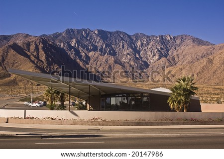 Palm Springs Visitor Center (the old Tramway Gas Station) a classic example of Desert Modern architecture with the San Jacinto mountains in the background and reflection in the glass.