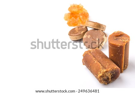 Palm sugar, coconut sugar and sugar cane rock  over white background - stock photo