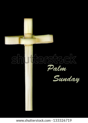 Palm Sunday - traditional cross made from leaf, isolated over black - stock photo