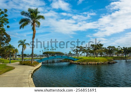 Palm tree and bridge at Rainbow Lagoon Park in Long Beach, California.