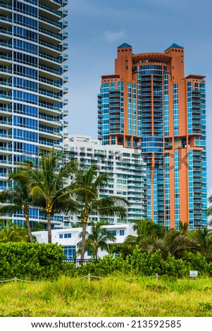 Palm trees and highrises in South Beach, Miami, Florida. - stock photo
