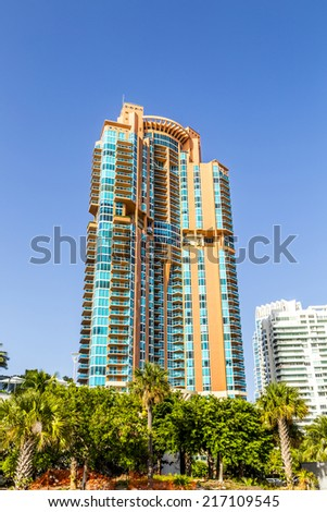 Palm trees and highrises in South Beach, Miami, Florida - stock photo