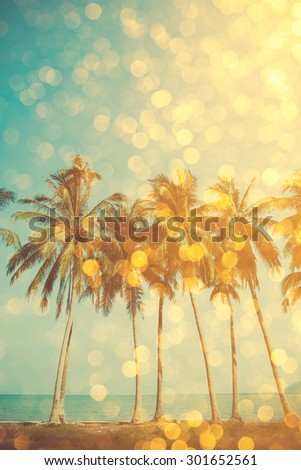 Palm trees on tropical beach with golden party glamour bokeh overlay, double exposure effect stylized - stock photo
