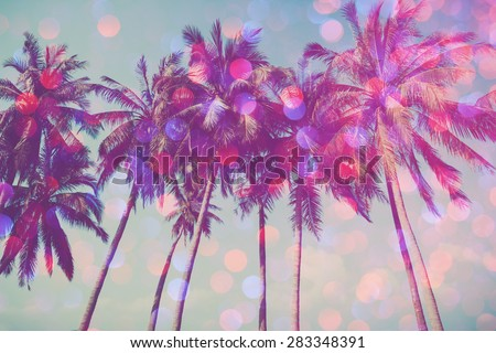 Palm trees on tropical beach with party glamour bokeh overlay, double exposure effect stylized - stock photo