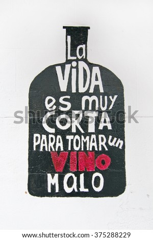 PALMA DE MALLORCA, BALEARIC ISLANDS, SPAIN - DECEMBER 21, 2015: Wall painting - Life is too short to drink bad wine in Spanish on December 21, 2015 in Palma de Mallorca, Balearic islands, Spain