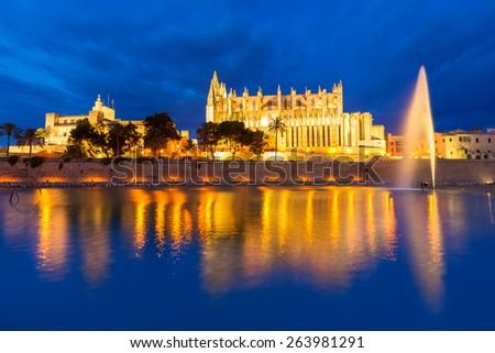 Palma de Mallorca Cathedral Seu sunset in Majorca Balearic islands of Spain - stock photo
