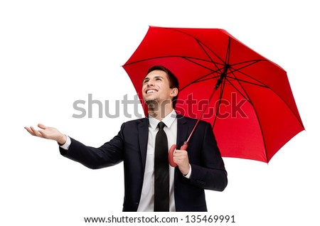 Palming up man with umbrella checks the rain, isolated on white - stock photo