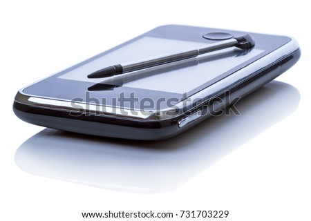 Palmtop (personal organizer) and stylus. Isolated on white background. General not branded appearance