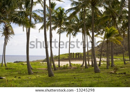palmtrees and statues at easter island - stock photo