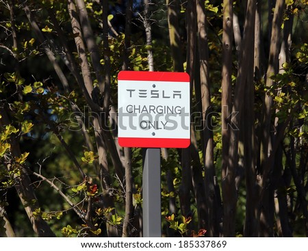 PALO ALTO, CA - MARCH 18: A charging station for Tesla brand electric cars in Palo Alto, CA on March 18, 2014. Tesla Motors is an American company that designs, manufactures and sells electric cars. - stock photo