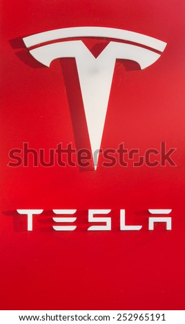 PALO ALTO, CA/USA - FEBRUARY 15: Tesla logo and showroom in Palo Alto, CA on Feb 15, 2015. Tesla is an American company that designs, manufactures, and sells electric cars. - stock photo