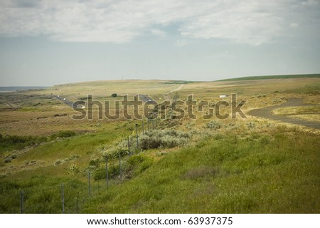 Palouse Hills crop fields on farmlands of  Washington state on highway abroad the ocean, USA - stock photo