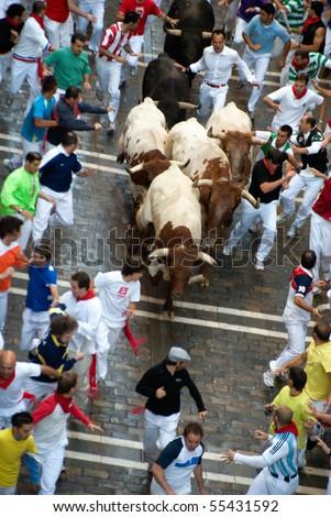 PAMPLONA-JULY 9:Aerial view of the Bull running in the calle Estafeta. Fiesta de San Fermin, Pamplona, Navarra, Spain 9 July 2008 in Pamplona Spain - stock photo