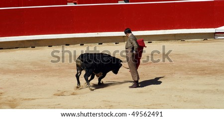 PAMPLONA, SPAIN - JULY 13: Bullfighting free festival that is celebrated in the parties in honor to San Fermin (Sanfermines celebrations) on July 13, 2009 in Pamplona, Spain. - stock photo