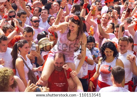 PAMPLONA, SPAIN -JULY 6: People are having fun at the opening of the San Fermin festival. Plaza in front of municipality. Pamplona, Navarra, Spain 6 July 2012 in Pamplona Spain.