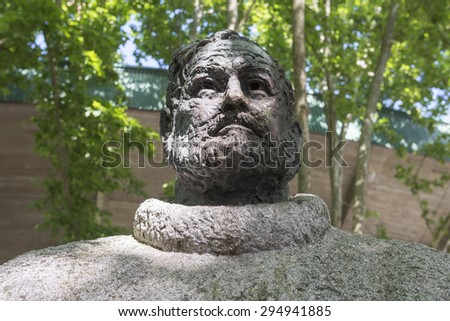 PAMPLONA, SPAIN - JUNE 18: The Statue of Ernest Hemingway outside of Pamplona bull ring (Spain), on June 18, 2015 in Pamplona, Spain