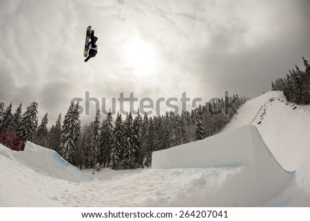 "PAMPOROVO,BULGARIA - MARCH 18 : Competitor performs trick during the ""Pamporovo Freestyle Open 14-19 March 2015"" in Pamporovo,Bulgaria on March 18, 2015 - stock photo"