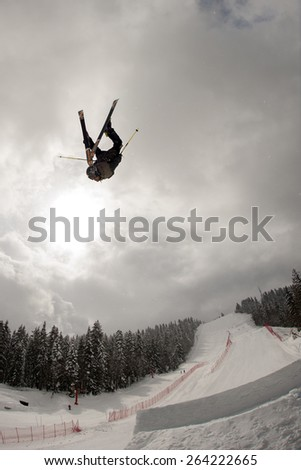 "PAMPOROVO,BULGARIA - MARCH 19 : Nikolaj Najdenov (BUL) performs trick during the ""Pamporovo Freestyle Open 14-19 March 2015"" in Pamporovo,Bulgaria on March 19, 2015 - stock photo"