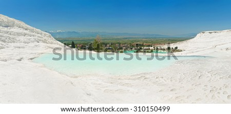 Pamukkale city and travertine terraces panorama with turquoise pool at front, Pamukkale, Turkey - stock photo