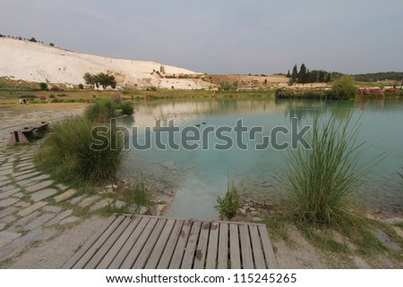 Pamukkale - terraces of carbonate minerals left by the flowing water - stock photo