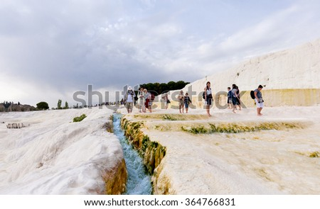 Pamukkale, Turkey - April 30, 2011 : Tourists on Pamukkale Travertine pools and terraces. Pamukkale is famous UNESCO world heritage site in Turkey