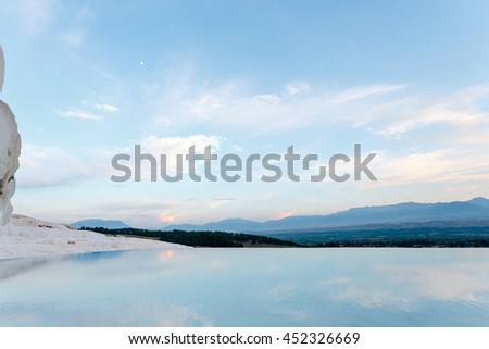 Pamukkale Turkey. blue water and reflection sky in travertine pool. - stock photo