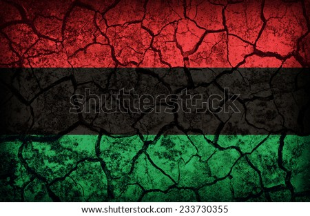 Pan-African  flag pattern on the crack soil texture ,retro vintage style - stock photo