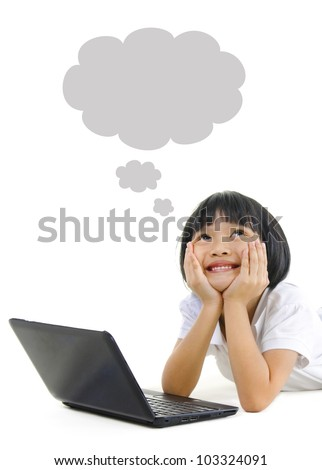 Pan Asian school girl using laptop and looking up - stock photo