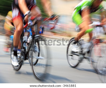 Pan blur of bicycle road race. - stock photo