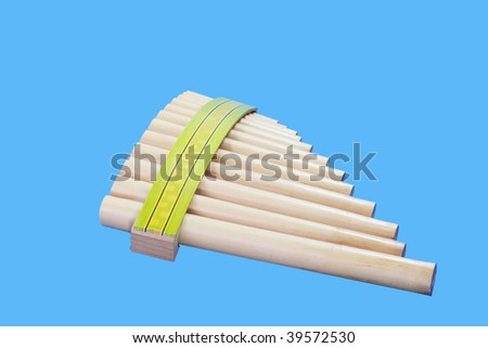 Pan flute isolated on blue background - stock photo