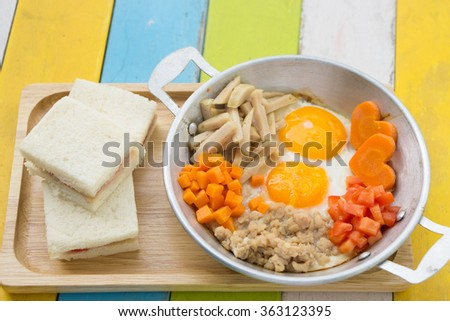 Pan fried eggs and sandwiches - stock photo