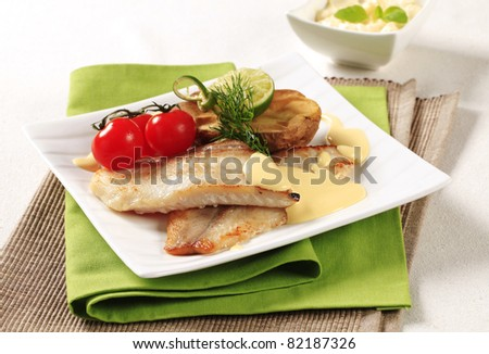 Pan fried fish fillets and Hollandaise sauce - stock photo