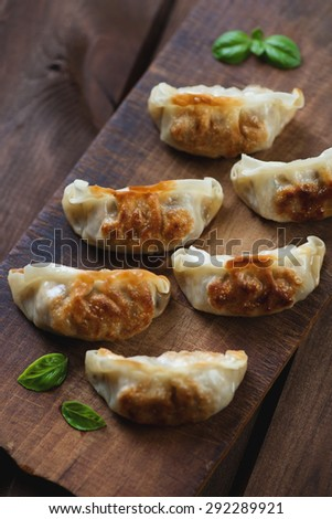 Pan fried japanese gyoza, rustic wooden setting, view from above
