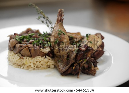 Pan fried pheasant with rice and mushrooms - stock photo