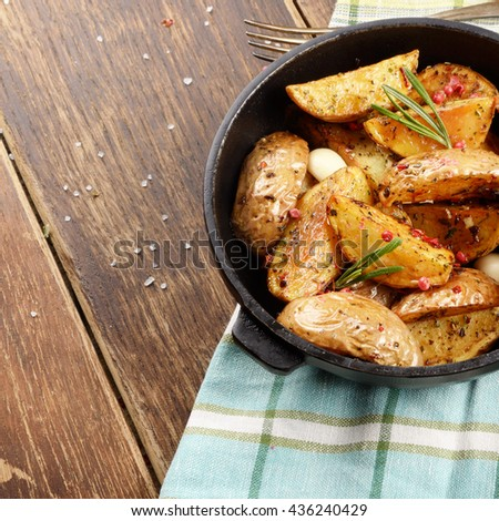 Pan Fried potatoes on baking paper rustic serving - stock photo
