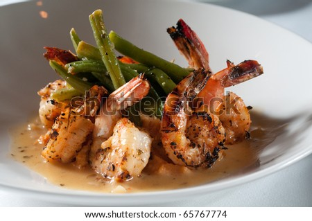 Pan fried shrimp and grits with green beans - stock photo