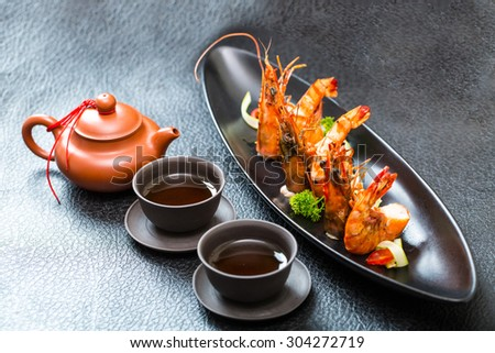 Pan fried tiger prawn with curl cucumber - stock photo